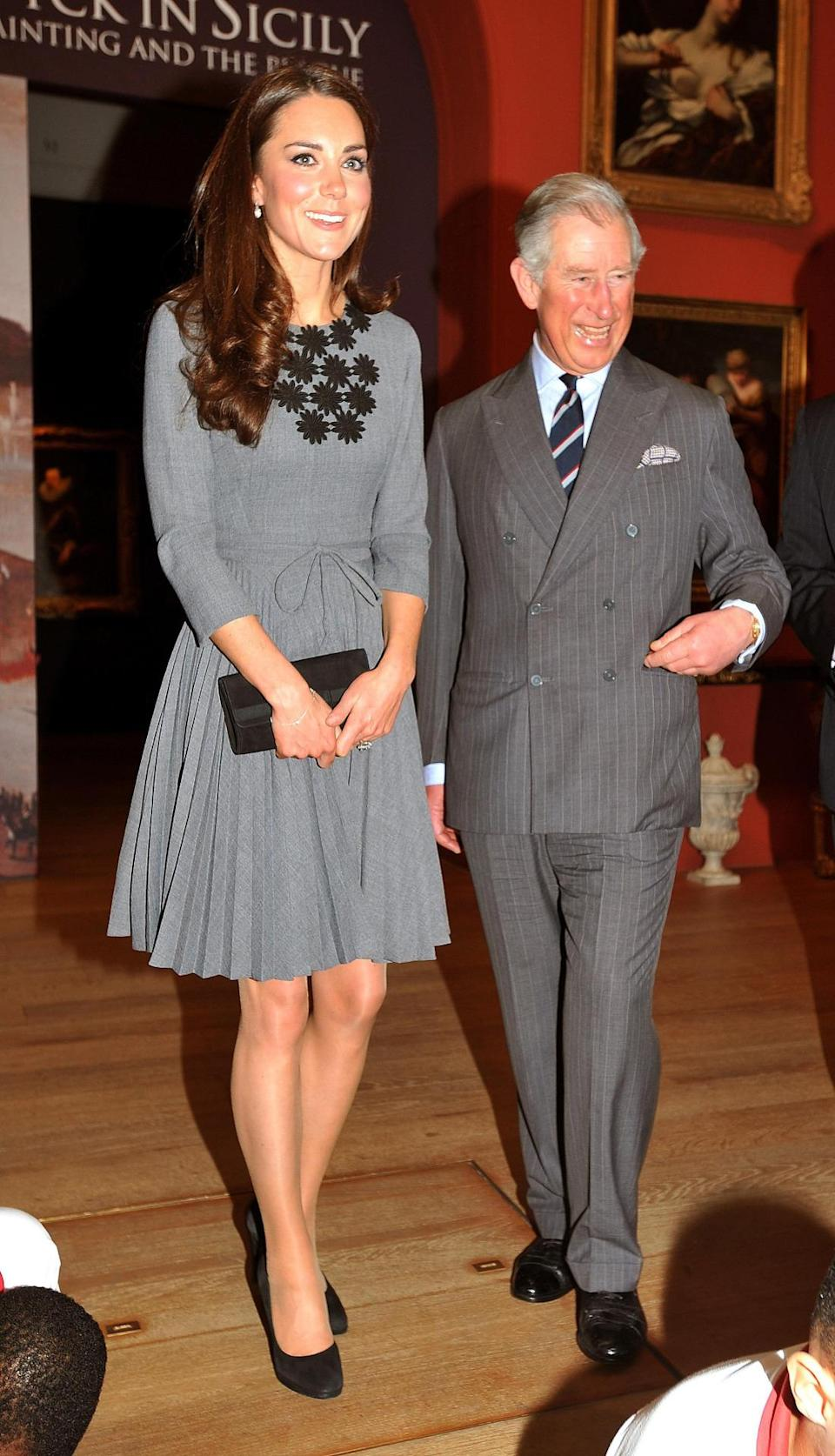<p>The Duchess donned a chic grey dress by Orla Kiely for a charity visit. </p><p><i>[Photo: PA]</i></p>