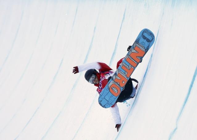 Canada's Brad Martin competes during men's snowboard halfpipe qualification round at 2014 Sochi Winter Olympic Games in Rosa Khutor