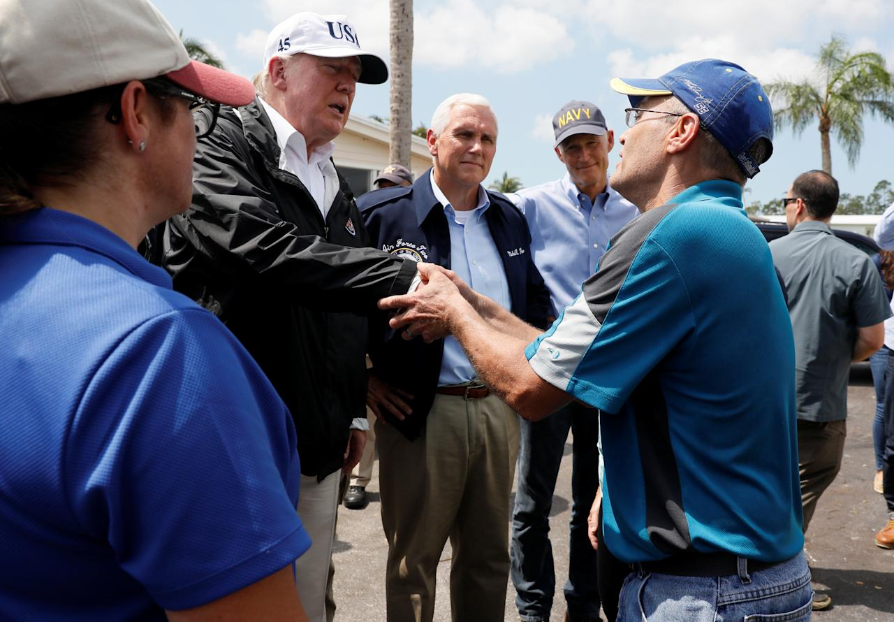 <p>President Donald Trump (2ndL) is accompanied by Vice President Mike Pence (C) and Florida Governor Rick Scott (2ndR) while meeting with people impacted by Hurricane Irma in Naples, Fla., Sept.14, 2017. (Photo: Jonathan Ernst/Reuters) </p>
