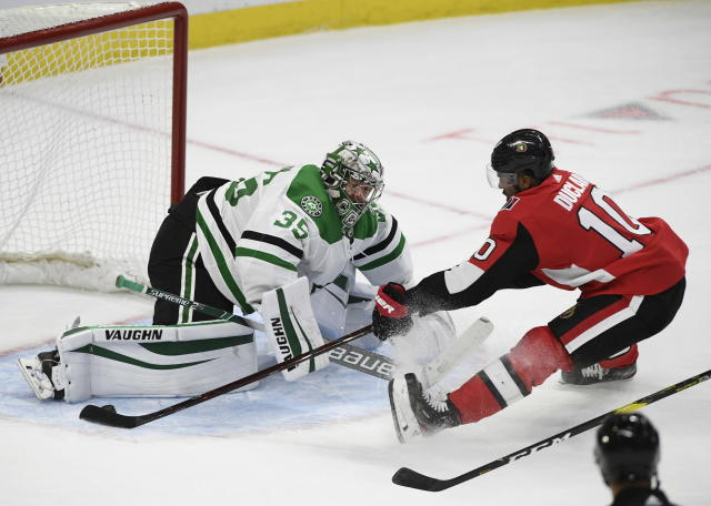 Dallas Stars goaltender Anton Khudobin (35) prevents Ottawa Senators left wing Anthony Duclair (10) from scoring on a breakaway during the third period of an NHL hockey game Sunday, Feb. 16, 2020, in Ottawa, Ontario. (Justin Tang/The Canadian Press via AP)