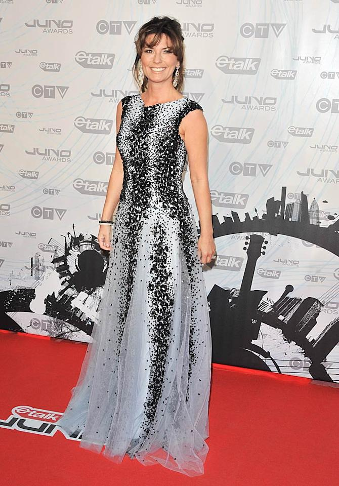 """Shania Twain has been MIA for quite some time, but the Canadian singing sensation recently reemerged at Toronto's 2011 Juno Awards in a beautifully beaded Zuhair Murad gown and chandelier earrings. You can see more of Shania beginning May 8, when her new docu-series, """"Why Not? With Shania Twain,"""" debuts on Oprah Winfrey's OWN. George Pimentel/<a href=""""http://www.wireimage.com"""" target=""""new"""">WireImage.com</a> - March 27, 2011"""