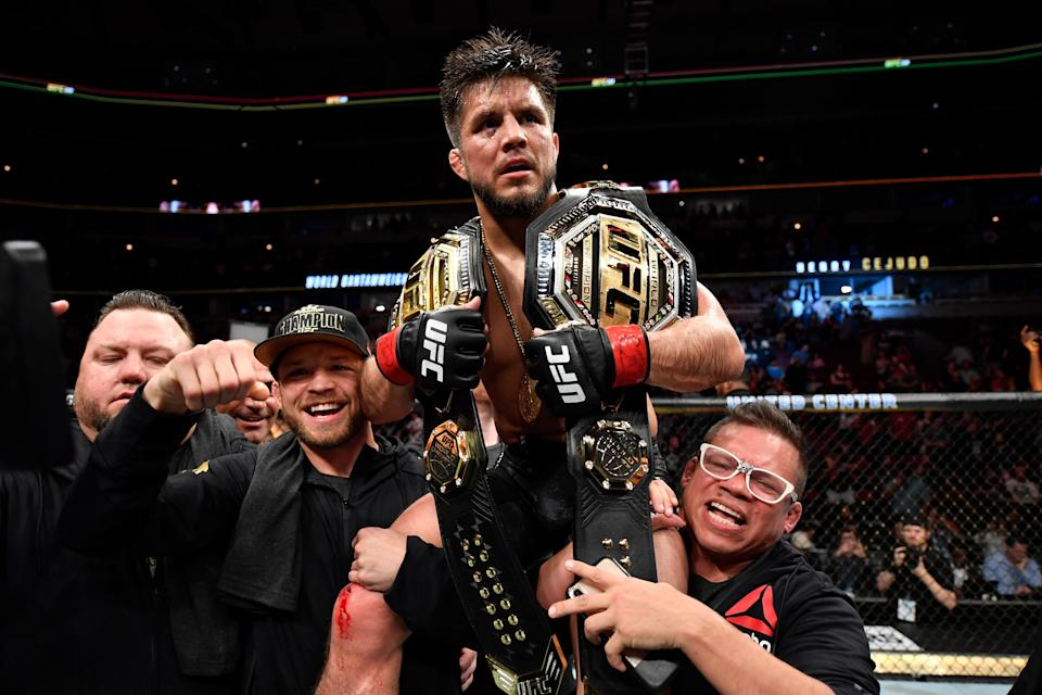 CHICAGO, IL - JUNE 08:  Henry Cejudo celebrates his TKO victory over Marlon Moraes of Brazil in their bantamweight championship bout during the UFC 238 event at the United Center on June 8, 2019 in Chicago, Illinois. (Photo by Jeff Bottari/Zuffa LLC/Zuffa LLC via Getty Images)