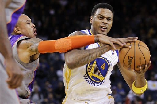 Phoenix Suns' Shannon Brown, left, defends against Golden State Warriors' Brandon Rush during the second half of an NBA preseason basketball game, Tuesday, Oct. 23, 2012, in Oakland, Calif. (AP Photo/Ben Margot)