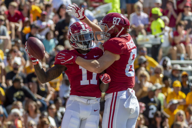 Alabama wide receiver Henry Ruggs III (11) celebrates his touchdown against Southern Miss with Alabama tight end Miller Forristall (87) during the first half of an NCAA college football game, Saturday, Sept. 21, 2019, in Tuscaloosa, Ala. (AP Photo/Vasha Hunt)