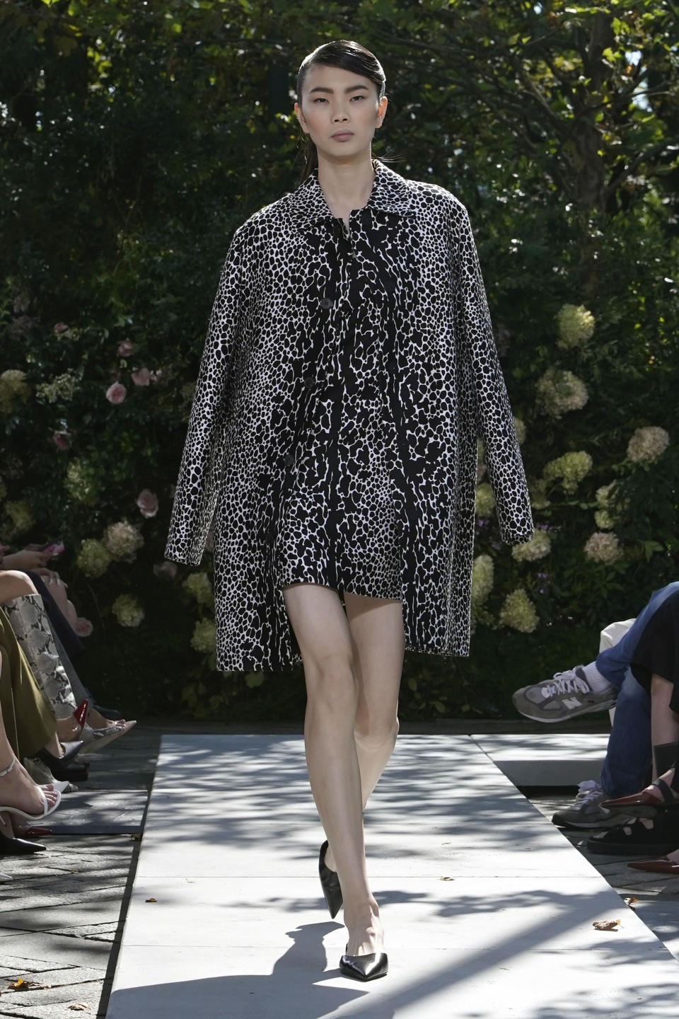 The Michael Kors Spring/Summer 2022 collection is modeled during Fashion Week, in New York, Friday, Sept. 10, 2021. (AP Photo/Richard Drew)