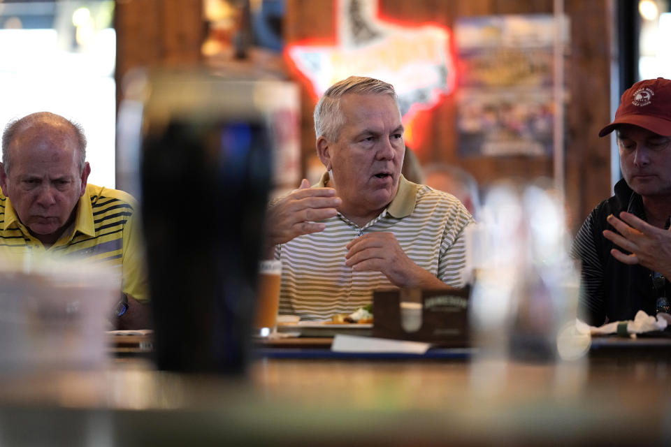 Customers eat at the bar inside Mo's Irish Pub Wednesday, March 10, 2021, in Houston. Texas Gov. Greg Abbott allowed the state mandates for COVID-19 safety measures to expire Wednesday. (AP Photo/David J. Phillip)