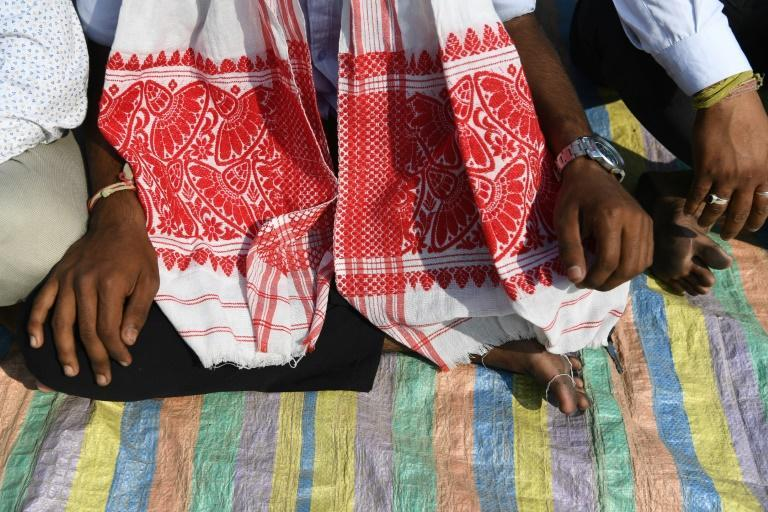 "The gamosa, a red and white cloth, has come to symbolise the struggle of the Indian state's indigenous ""sons of the soil"" against a new citizenship law"