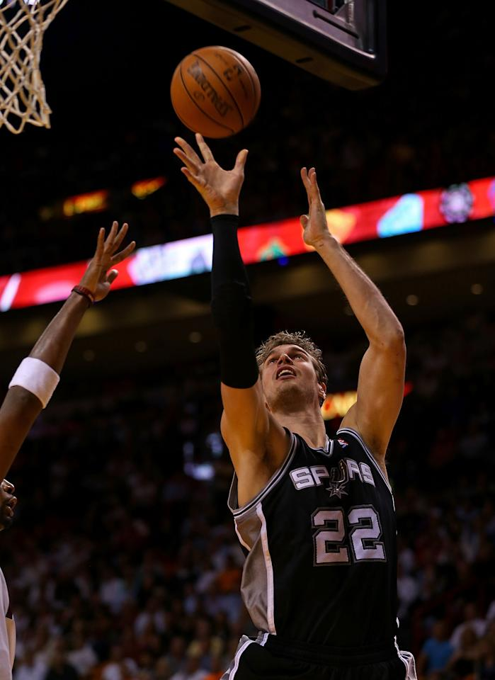 MIAMI, FL - NOVEMBER 29: Tiago Splitter #22 of the San Antonio Spurs drives to the basket during a game against the Miami Heat at American Airlines Arena on November 29, 2012 in Miami, Florida.  (Photo by Mike Ehrmann/Getty Images)