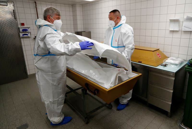FILE PHOTO: Undertakers transport a body of a woman who died from the coronavirus disease (COVID-19) in a coffin in Berlin