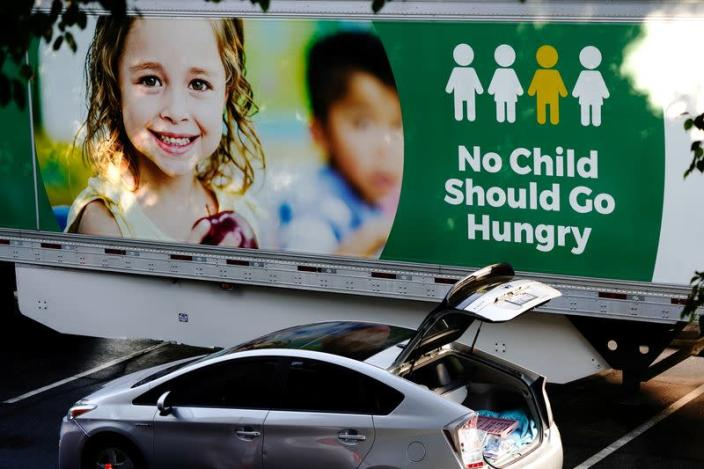 FILE PHOTO: Los Angeles Regional Food Bank drive-thru distribution in West Covina