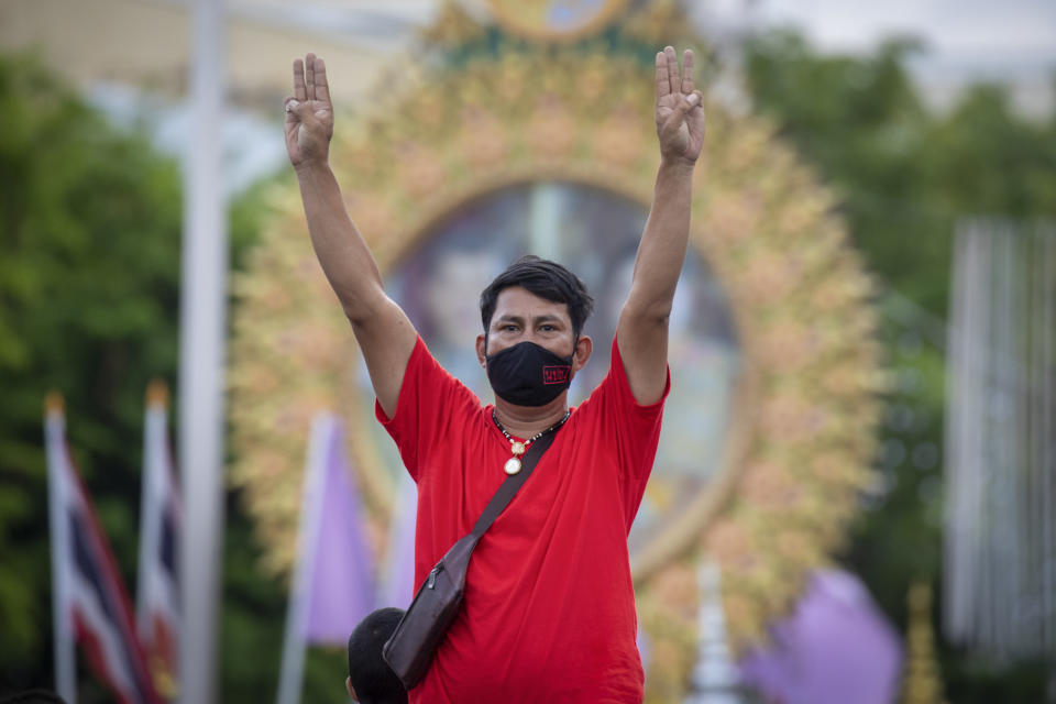 A Pro-democracy supporter displays the three-finger symbol of resistanc, during a demonstration in Bangkok, Thailand, Thursday, June 24, 2021. Pro-democracy demonstrators have taken to the streets of Thailand's capital again, marking the 89th anniversary of the overthrow of the country's absolute monarchy by renewing their demands that the government step down, the constitution be amended and the monarchy become more accountable. (AP Photo/Wason Wanichakorn)