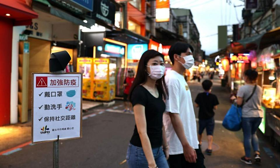 People at a night market in Taipei