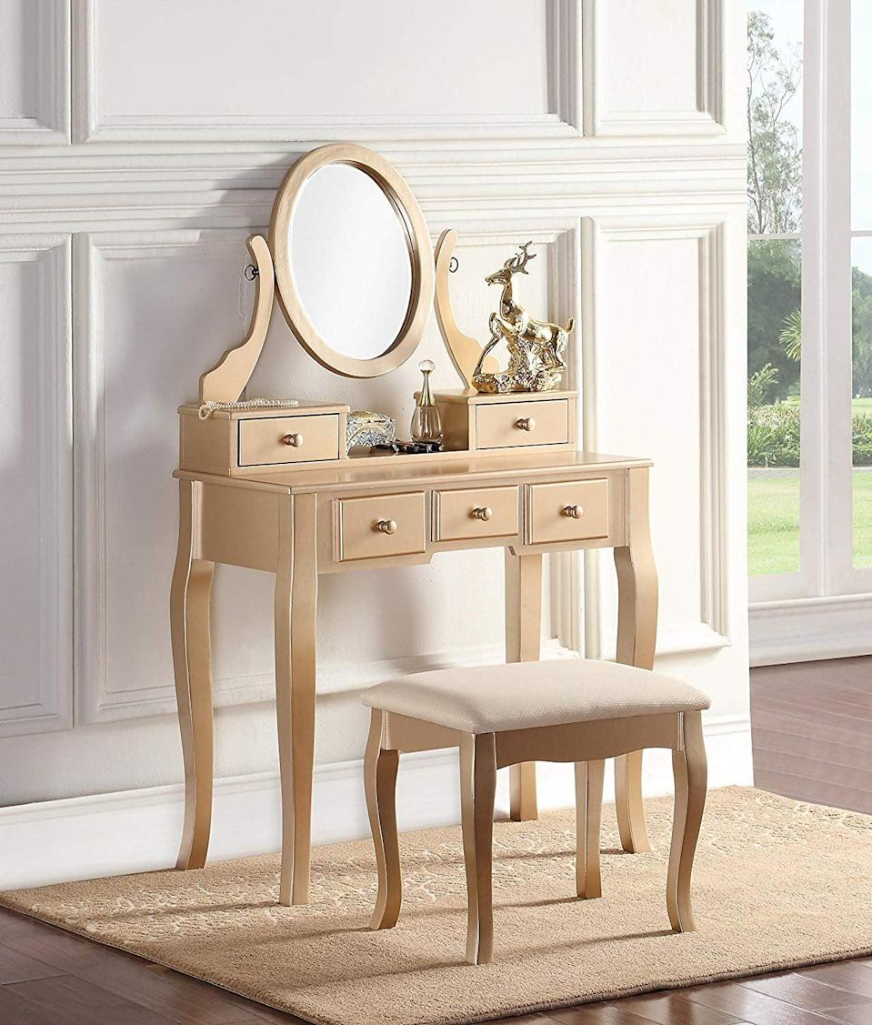 <p>This gold <span>Roundhill Furniture Ashley Wood Vanity Set</span> ($169) looks so luxe. You can also get this in white, silver, and cherry wood.</p>