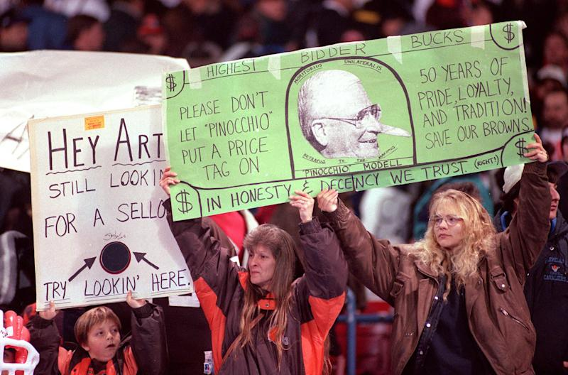 FILE - This Nov. 26, 1995 file photo shows fans holding signs during a game against the Pittsburgh Steelers at Cleveland Stadium in Cleveland. 1995 file photo. Former Baltimore Ravens owner Art Modell has died. He was 87. The team said Modell died of natural causes early Thursday, Sept. 6, 2012, at Johns Hopkins Hospital, where he had been admitted Wednesday. Modell was among the most important figures in the NFL as owner of the Cleveland Browns, who became the Ravens after he took the team to Baltimore in 1996 _ a move that hounded him the rest of his life. (AP Photo/The Repository, Scott Heckel) MANDATORY CREDIT