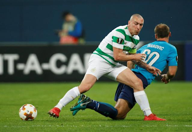Soccer Football - Europa League Round of 32 Second Leg - Zenit Saint Petersburg vs Celtic - Stadium St. Petersburg, Saint Petersburg, Russia - February 22, 2018 Celtic's Scott Brown in action with Zenit St. Petersburg's Branislav Ivanovic REUTERS/Maxim Shemetov