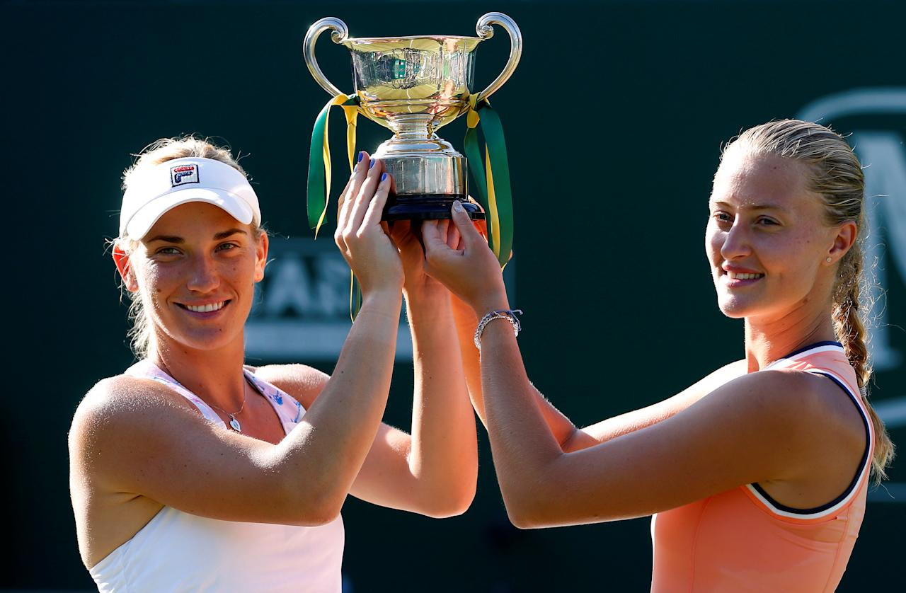 Tennis - WTA Premier - Nature Valley Classic - Edgbaston Priory Club, Birmingham, Britain - June 17, 2018  Hungary's Timea Babos and France's Kristina Mladenovic celebrate with the trophy after winning their doubles final against Belgium's Elise Mertens and Demi Schuurs of the Netherlands  Action Images via Reuters/Ed Sykes