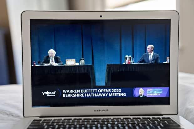 Greg Abel, right, is shown to the right of Berkshire founder Warren Buffett in this shot from the company's annual general meeting in Omaha, Nebraska. (Andrew Harrer/Bloomberg - image credit)
