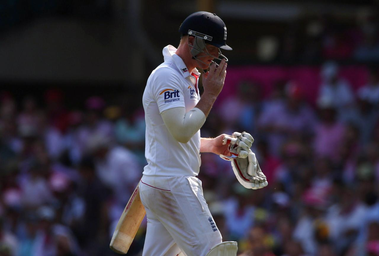 England's Ben Stokes walks off the field after his dismissal by Australia's Ryan Harris during the third day of the fifth Ashes cricket test at the Sydney cricket ground January 5, 2014. REUTERS/David Gray (AUSTRALIA - Tags: SPORT CRICKET)