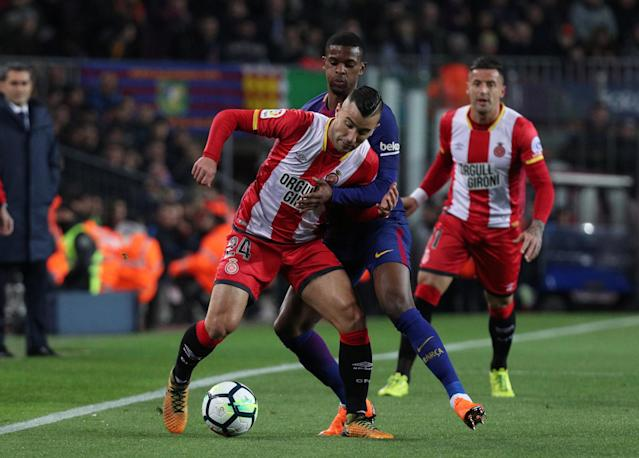 Soccer Football - La Liga Santander - FC Barcelona vs Girona - Camp Nou, Barcelona, Spain - February 24, 2018 Girona's Borja in action with Barcelona's Nelson Semedo REUTERS/Sergio Perez