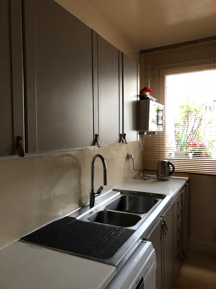 """<div class=""""caption""""> <strong>BEFORE:</strong> The basic layout of the kitchen was fine but needed a jolt of color and modernity. </div>"""