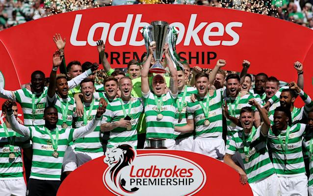 A ridiculously eventful climax to the Scottish Premiership schedule saw Celtic, Aberdeen, Hibernian and Rangers embroiled in a spectacular resolution of the final league placings. Celtic, of course, were guaranteed a seventh successive title party, which duly proceeded at a packed Parkhead, but only after they had lost at home to Scottish opponents for the first time since Brendan Rodgers became Hoops manager in the summer of 2016. The setback was inflicted by Aberdeen, for whom Andrew Considine's 47th-minute goal ended a lamentable run of 25 consecutive defeats over 14 years of visits to the east end of Glasgow, hence the visitors' celebrations after the final whistle, although these were marred somewhat when Shay Logan was shown a post-match red card for his part in an altercation with Mikael Lustig. Considine's contribution also guaranteed the Dons the runners-up spot for the fourth year in a row and quashed Rangers' hopes of a second-place finish to an otherwise dispiriting season. In fact, within 22 minutes of their visit to Easter Road, Rangers looked on the verge of a humiliation as great as those inflicted by Celtic in the William Hill Scottish Cup semi-final and in the title clincher last month. Hibernian raced to a 3-0 lead, beginning their scoring spree with a Florian Kamberi penalty after Jamie Maclaren had been fouled by David Bates, the Rangers defender who was playing his last game for the club before heading to Hamburg during the close season. Jamie Maclaren scrambles home a 90th minute equaliser Credit: Getty images Scott Allan made it 2-0 when he connected at close range with a prompt from Vykintas Slivka and Maclaren netted Hibs' third with a header from a Lewis Stevenson cross midway through the first half. At that stage of the proceedings there seemed to be a significant chance that Hibs could get to 6-0, the scoreline required to displace the Ibrox side from third place in the table. Instead, Rangers retorted with three goals inside a quarter o