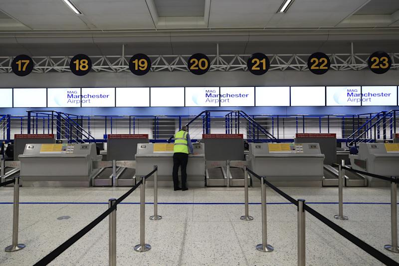 Empty check-in desks at the Thomas Cook section of Manchester Airport