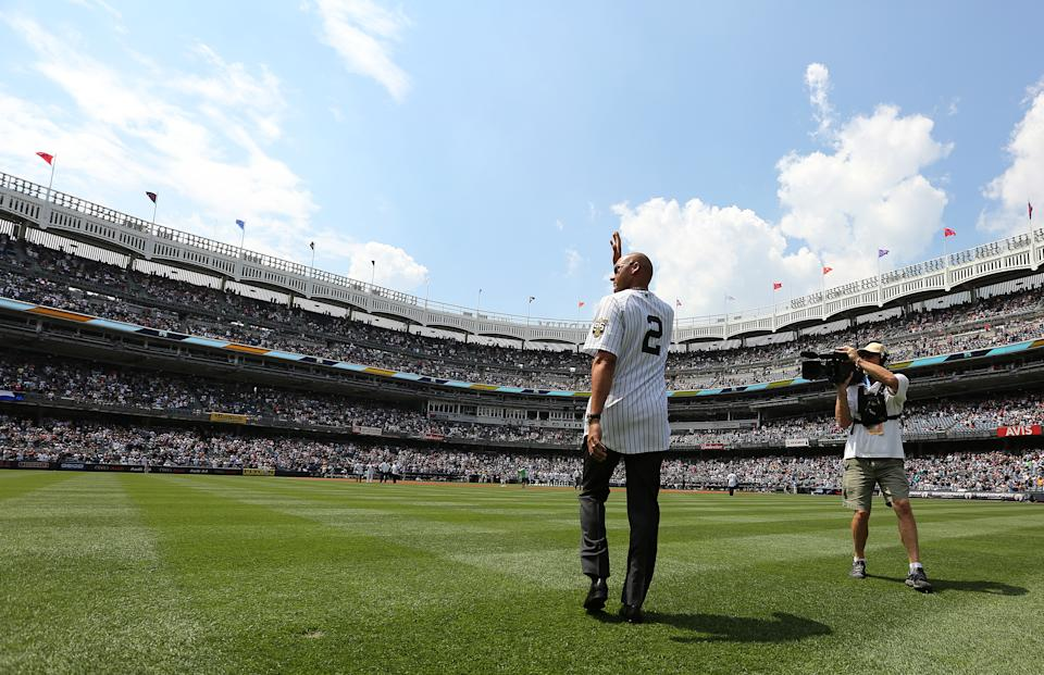 NEW YORK, NY - AUGUST 13: Former New York Yankee Derek Jeter waves as he is introduced during a ceremony honoring the '96 Yankee championship before a game against the Tampa Bay Rays inning of a game at Yankee Stadium on August 13, 2016 in the Bronx borough of New York City. (Photo by John Munson-Pool/Getty Images)