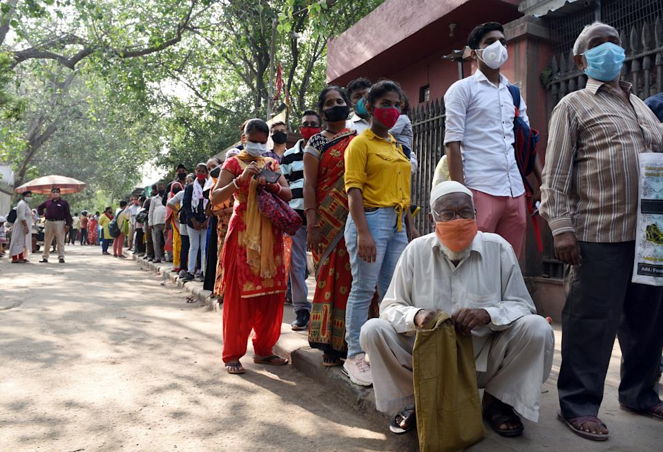 NEW DELHI, INDIA - JUNE 21: Non-Covid patients, not adhering to social distancing norms, wait in a long queue for OPD services at G B Pant Hospital, on June 21, 2021 in New Delhi, India. (Photo by Arvind Yadav/Hindustan Times via Getty Images)