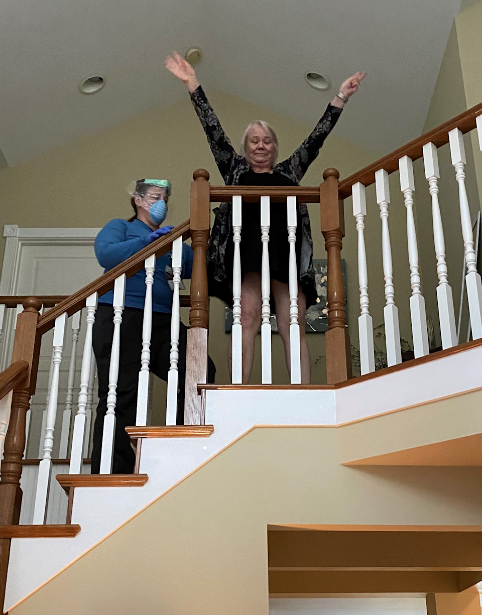 Peggy makes it up the 16 steps to the upper floor of her home in Marysville, Washington.