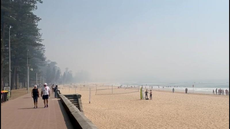 Still image taken from a social media video shows haze blanketing Manly Beach in Sydney, Australia