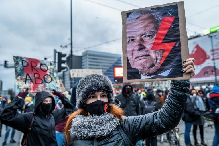 A court decision to ban terminations in cases of foetal anomaly has fomented protest -- here, a woman's anti ruling PiS party banner shows the red lightning bolt symbol of the women's strike movement