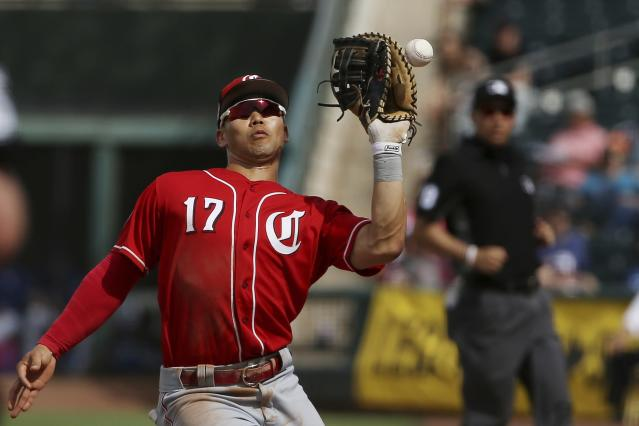 Cincinnati Reds' Connor Joe misplays a pop fly foul ball hit by Texas Rangers' Elvis Andrus during the fifth inning of a spring training baseball game Wednesday, March 20, 2019, in Surprise, Ariz. (AP Photo/Ross D. Franklin)