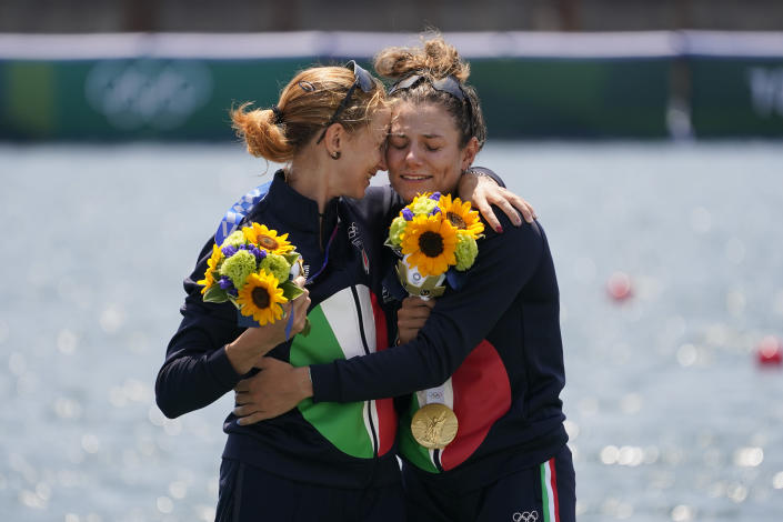 Valentina Rodini and Federica Cesarini of Italy pose with the gold medal in the lightweight women's double sculls final at the 2020 Summer Olympics, Thursday, July 29, 2021, in Tokyo, Japan. (AP Photo/Darron Cummings