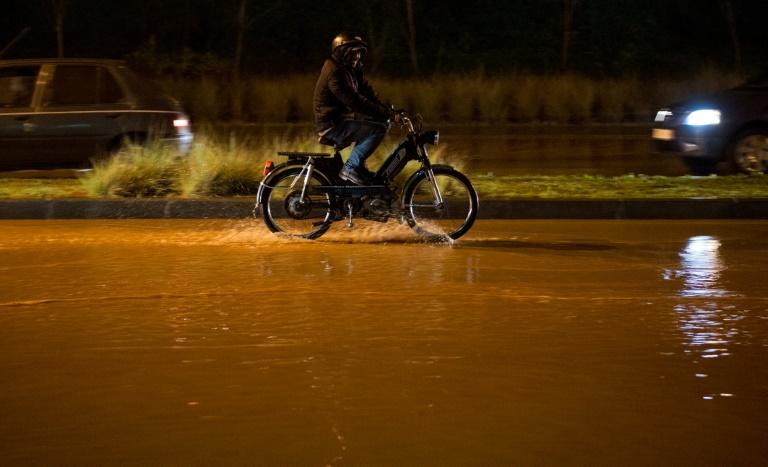 Floods are common in Morocco: A man rides through muddied flood waters between Sale and the Moroccan capital of Rabat in February 2017