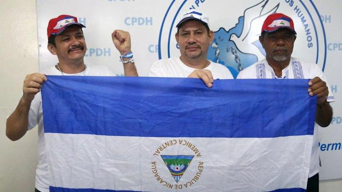 farmers' Movement leaders Medardo Mairena, Pedro Mena and Freddy Navas celebrate after being released on 11 June, 2019 in Managua