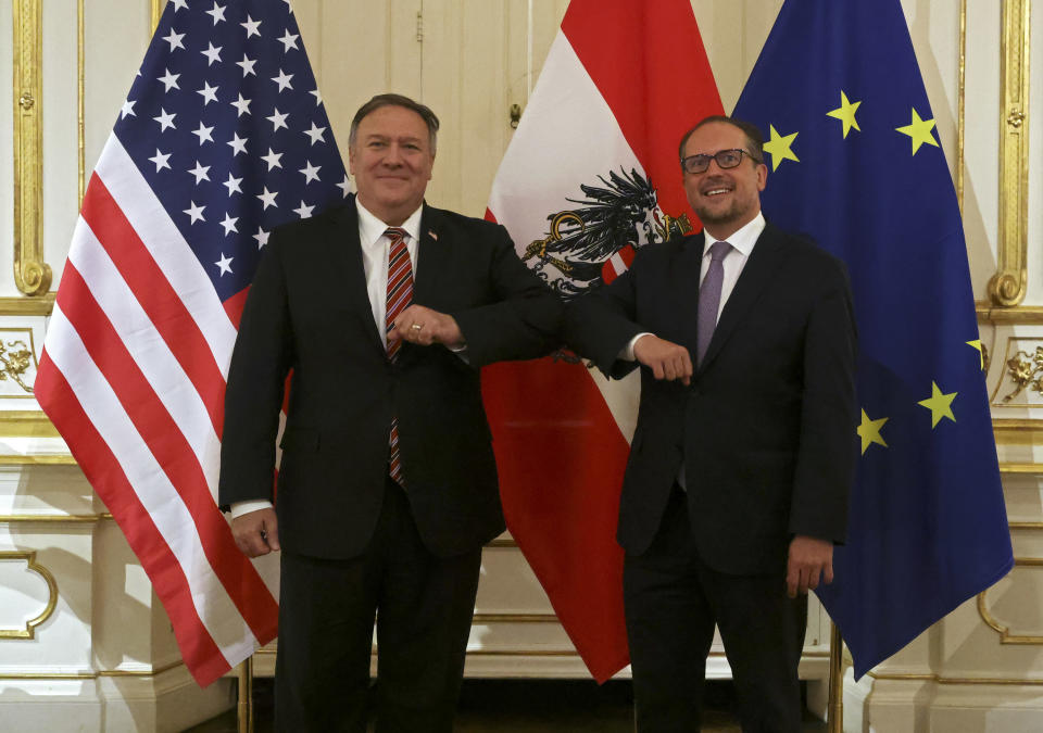 U.S. Secretary of State Mike Pompeo, left, meets Austrian Foreign Minister Alexander Schallenberg at Belvedere Palace in Vienna, Austria, Friday Aug. 14, 2020. Pompeo is on a five-day visit to central Europe. (Lisi Niesner/Pool via AP)