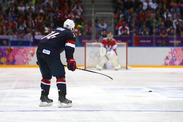 SOCHI, RUSSIA - FEBRUARY 15: T.J. Oshie #74 of the United States scores on a shootout against Sergei Bobrovski #72 of Russia during the Men's Ice Hockey Preliminary Round Group A game on day eight of the Sochi 2014 Winter Olympics at Bolshoy Ice Dome on February 15, 2014 in Sochi, Russia. (Photo by Streeter Lecka/Getty Images)