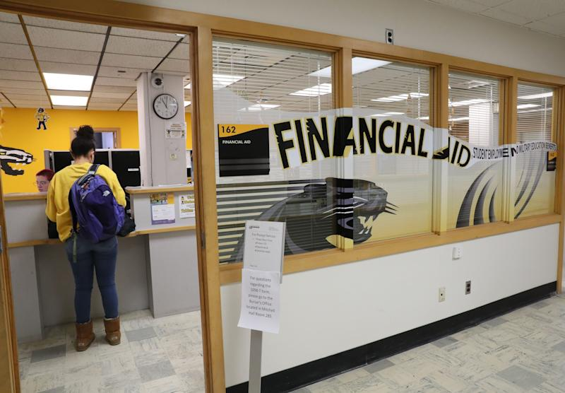 The University of Wisconsin-Milwaukee financial aid office is a busy place as students come in with forms and questions.