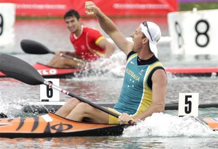 Australian Nathan Baggaley celebrates his victory in the men's K1, 500 metres race during the flat water Canoe and Kayak World Championship in Zagreb August 28, 2005. REUTERS/Nikola Solic