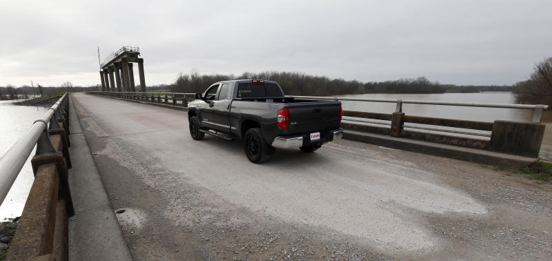 A truck passes on top of the levee at the Steele Bayou Drainage Structure in Warren County, Miss., as water from recent rainfalls rises on both sides in this Friday, March 1, 2019 photograph. As Mississippi River backwaters in the Eagle Lake area are at flood level and are projected to rise even higher, it is causing limited access to residents by emergency vehicles. The levee protects thousands of square miles of the Delta region from even worse flooding by the Mississippi River. (AP Photo/Rogelio V. Solis)