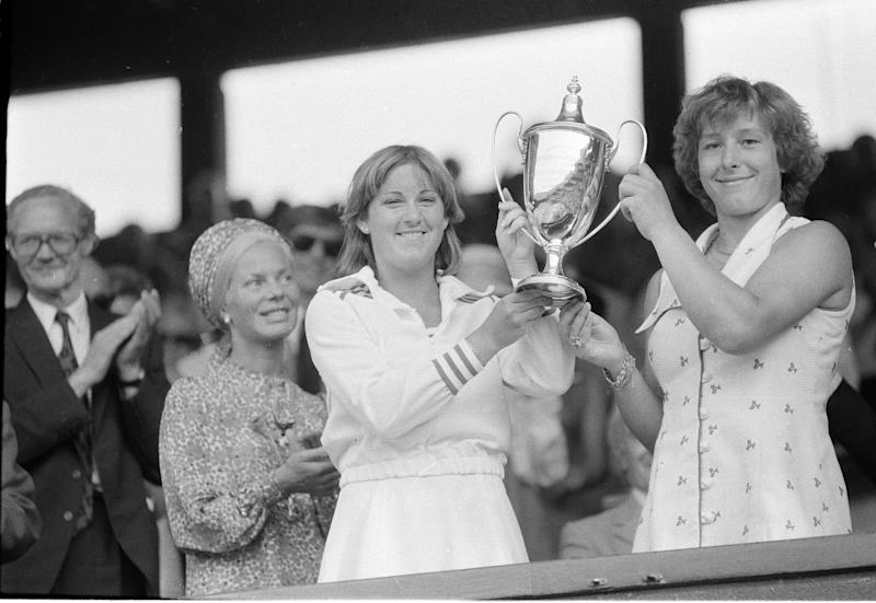America's Chris Evert, left, and Martina Navratilova display their trophy to the crowd after winning the Women's Mixed Doubles of the Wimbledon Tennis Championship, in Wimbledon, England, July 3, 1976. Evert and Navratilova beat Billie Jean King and Betty Stove 6-1, 3-6, 7-5 to win the title.