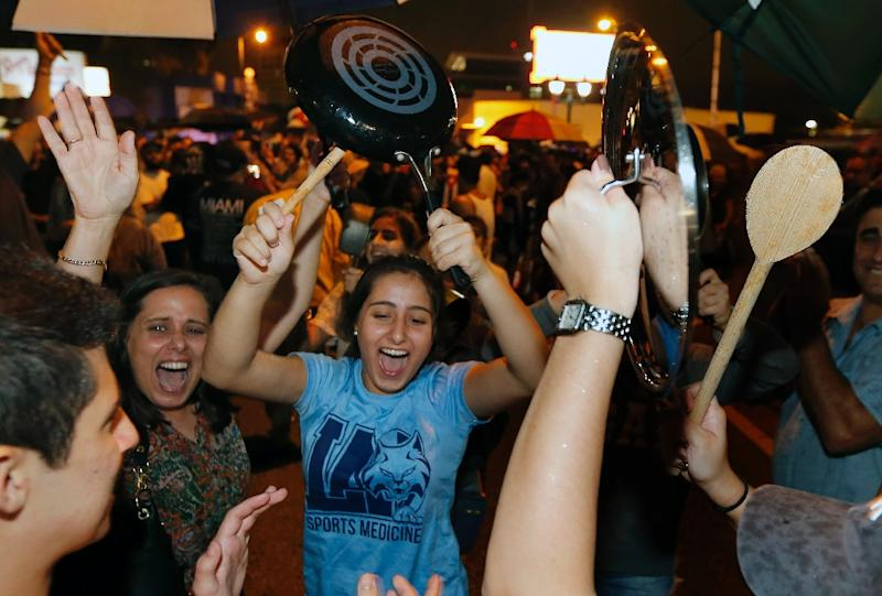 Cuban Americans celebrate news of Fidel Castro's death in Little Havana neighborhood of Miami, Florida on November 26, 2016 (AFP Photo/Rhona Wise)