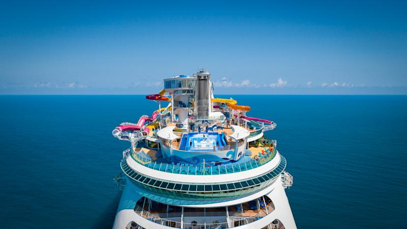 Royal Caribbean Navigator of the Seas, OOH, drone shot above aft deck, showing rides and FlowRider, ocean horizon in background,.