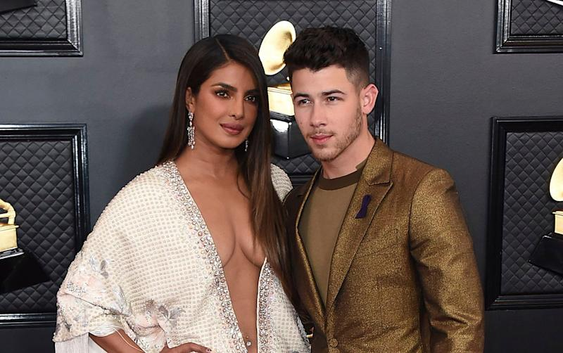 Priyanka Chopra Shows Off Her Belly Ring In Retro Gown With Nick