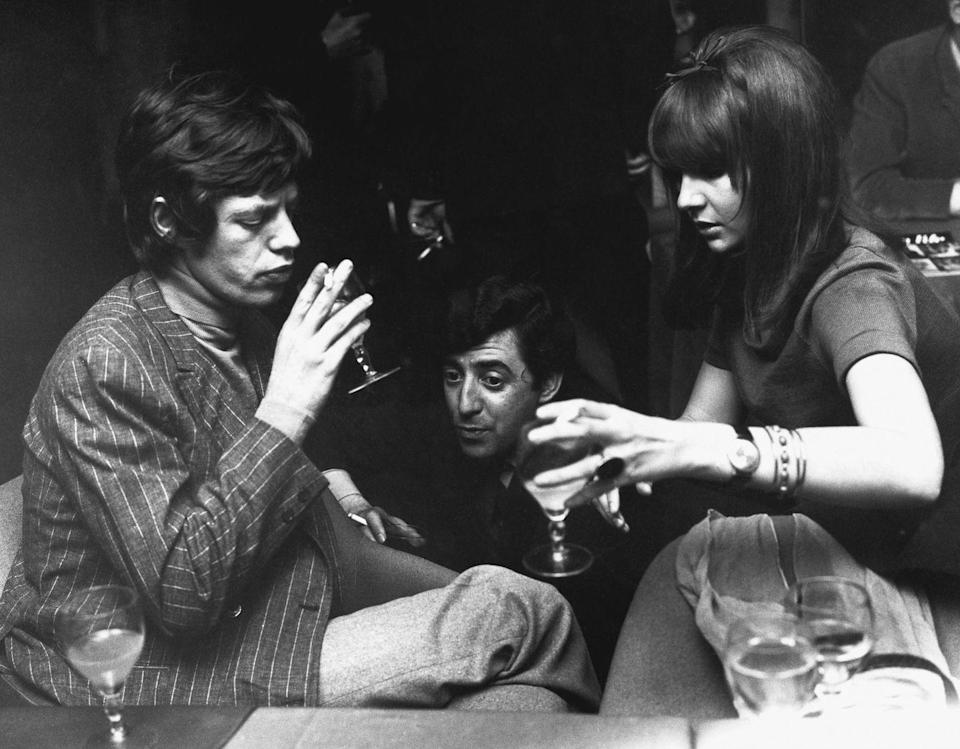 <p>The singer shares a few cocktails with his then-girlfriend, Chrissie Shrimpton, at a London hotspot, 1966. </p>