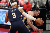 New Orleans Pelicans guard JJ Redick and guard Josh Hart (3) grab a rebound away from the Toronto Raptors during the second half of an NBA basketball game Wednesday, Dec. 23, 2020, in Tampa, Fla. (AP Photo/Chris O'Meara)