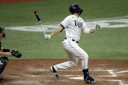 Tampa Bay Rays' Austin Meadows follows through on a two-run single off New York Yankees relief pitcher Luis Avilan during the fourth inning of the second game of a doubleheader baseball game Saturday, Aug. 8, 2020, in St. Petersburg, Fla. RaysTampa Bay Rays' Willy Adames and Kevin Kiermaier scored. (AP Photo/Chris O'Meara)