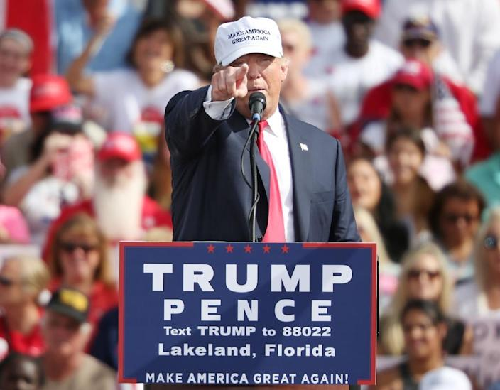 """Republican presidential nominee Donald Trump continued to slam """"disloyal"""" Republicans on October 12, 2016, telling Florida supporters that Speaker of the House Paul Ryan should have called to congratulate him after the debate (AFP Photo/Gregg Newton)"""