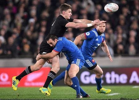 FILE PHOTO: Rugby Union - June Internationals - New Zealand vs France - Eden Park, Auckland, New Zealand - June 9, 2018 - New Zealand's Beauden Barrett is tackled by France's Morgan Parra. REUTERS/Ross Setford