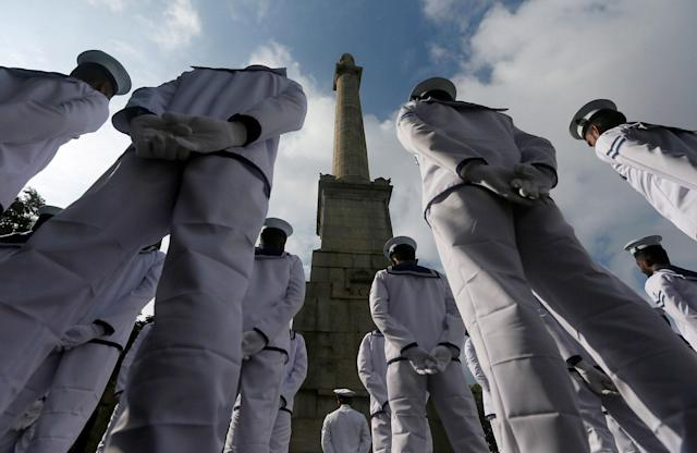 <p>Sri Lankan Navy soldiers stand in front of the War Memorial, during an event marking Remembrance Day, also known as Poppy Day, to commemorate the sacrifices of members of the armed forces and of civilians in times of war, in Colombo, Sri Lanka, Nov. 11, 2017. (Photo: Dinuka Liyanawatte/Reuters) </p>